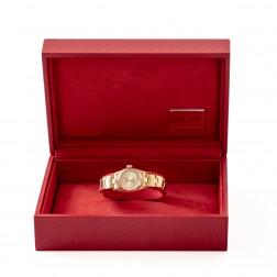 Montre Rolex pour dame Oyster Perpetual en or jaune 18k lunette crenelée